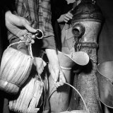 Civilians Filling Wine Jugs with Fresh Water after City was Restored in the Wake of Germans  WWII
