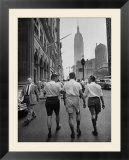 Three Young Businessmen Wearing Bermuda Shorts as They Walk Along Fifth Ave During Lunchtime