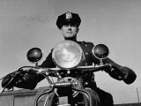 NYPD Motorcycle Cop Francis Kennedy Patrolling the Streets on His Bike