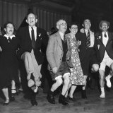 People Celebrating Devaluation of the Pound During a Labor Party Rally