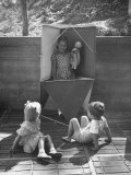 Children Playing in a Toy Made by Charles Eames