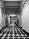 One of the Long Corridors in the State Dept Building with a Messenger Desk Out in the Hall