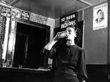 Woman Drinking under Sign  No Beer Sold to Indians  Katherine's Place  Happy Hollow  Fort Peck Dam