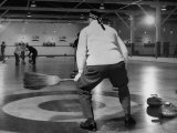 Men Curling with Mops and Brooms