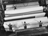 20 Ft Roll of Finished Paper Arriving on the Rewinder  Ready to Be Cut and Shipped from Paper Mill