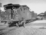 Wartime Railroading: Conductor Hopping Aboard Caboose of No 15 Bound for Augusta  GA