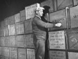 Man Marking the Imported Shipment at the Bush Terminal