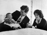 Sen Jack Kennedy Cuddling Baby Daughter Caroline  Smiling as Mom Looks on in Delight