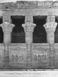Columns and Carvings Along Wall of Temple at Denderah