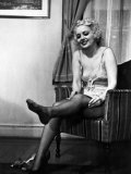 Ex-Burlesque Stripper June St Clair Removing Stockings at the Allen Gilbert School of Undressing