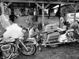 Black Motorcyclist of the Big Circle Motorcycle Association Sitting Between Harley Davidson Bikes