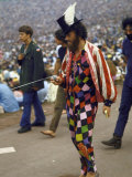 Paul Foster Walking During the Woodstock Music and Art Festival