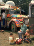 Man Seated with Two Young Boys in Front of a Wildly Painted School Bus  Woodstock Music Art Fest