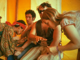 Two Women Giving Medical Care to Men  During the Woodstock Music and Art Fair