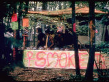 Paraphernalia Stand in Woods Featuring Pillows  Posters  and Incense  Woodstock Music and Art Fair