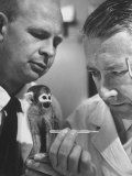 US Navy Beischer and Dr Stullken Taking Temperature of Monkey Who Survived Trip into Space