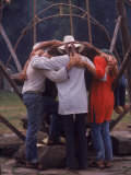 Young People Huddled Together in Front of Swing at a Playground  Woodstock Music and Art Fair