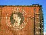 Old Weathered Box Car Showing Design Promoting Travel to Glacier National Park