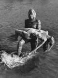 Actress Julia Adams is Carried by Monster  Gill Man  in the Movie  Creature from the Black Lagoon