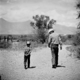 Rancher James A Shugart Walking a Dusty Road with Son James Jr