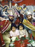 Two Sisters Posing with Men Dressed as Magi During Christmas Festival