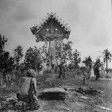 American GI Kneeling in Prayer in Front of Crucifix at a Catholic Shrine  after US Invasion
