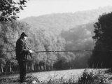 Fisherman on Banks of European Waterway