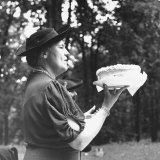Mrs Ernest Humphrey Daniels Offering Cake at Bake Sale Held  American Federation of Women's Clubs