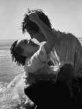 Actress Terry Moore Hugging Actor Robert Wagner on the Beach