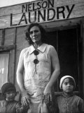 Mrs Nelson with Her Two Children Outside Her Laundry Which She Operates without Running Water