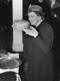 Mrs Harvey C Wiley Inspecting Cake at Bake Sale  American Federation of Women&#39;s Clubs
