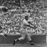 Action Shot of Chicago Cub's Ernie Banks Smacking the Pitched Baseball