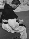 Catholic Monk Reading His Bible in the Church Courtyard
