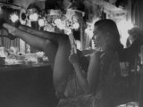 Chorus Girl-Singer Linda Lombard  Resting Her Legs after a Tough Night on Stage