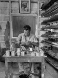 Shoemaker Sitting in His Shop Working on a Pair of Old Work Shoes
