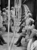 Actress Shelley Winters  Sitting in Booth with Mirrors on All Sides