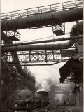 Steaming Hot Steel Slag Being Poured into Freight Cars on Railroad Siding at Steel Plant