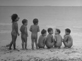 Children Standing on the Beach Naked