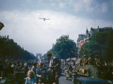 Cub Plane Flying Above the Degaulle Parade on the Champs Elysees