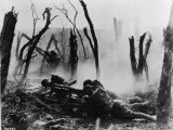 American Soldiers of 23rd Inf Firing a 37-MM Gun at German Positions in the Argonne Forest  WWI