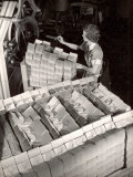 Woman Typing Up Bundles of Paper Bags as They are by Machine Inthe Union Bag and Paper Co Factory
