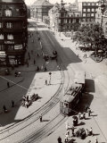 Pedestrians Waiting for Streetcar in Quiet Town with Recent Nazi Outbreaks on the Polish Border
