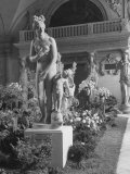 The Statue of Aphrodite and Eros in Louvre Museum During a Flower Show