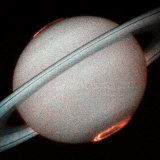 The Planet Saturn  North and South Poles Ablaze  Taken by the Hubble Space Telescope