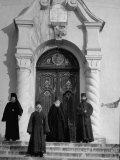 Rumanian Monks Posing on Steps in Front of Main Door to the Greek Orthodox Monastery