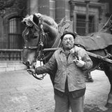 Drayman Frederic Lemercier Carrying Discarded Flowers From a Flower Show