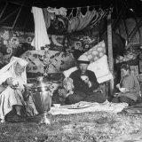 Kazak Family Sitting on Floor and Eating