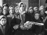Russian Woman Grimly Holding a Slab of Meat as Other Peasant Women Staunchly Stand by in Siberia
