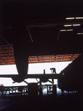 "Women Silhouetted as They Work on B-24 ""Liberator"" Bomber  Bechtel-McCone-Parsons USAF Center"