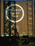 Section of Railroad Box Car W Logo of the Atlantic Coast Line Railroad  Obscured by Shadow
